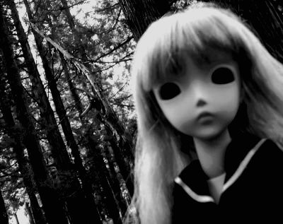 creepy doll in woods